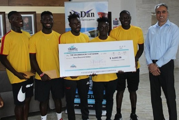 The team holding the cheque donation from McDan