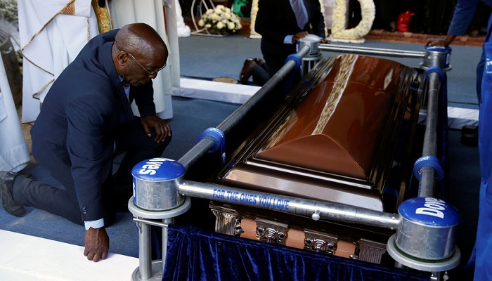 Pallbearers carry the remains of late President Mugabe