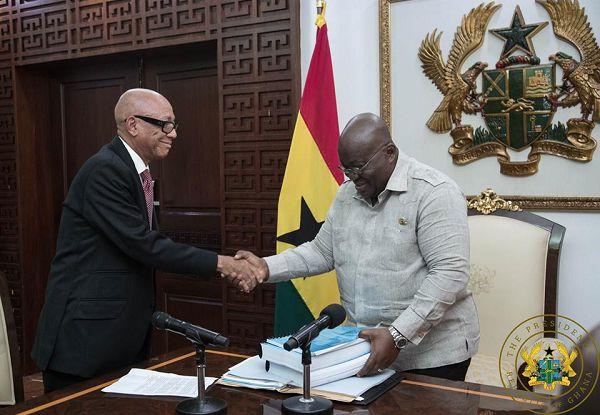 President Akufo-Addo receives the report from Justice Emile Short