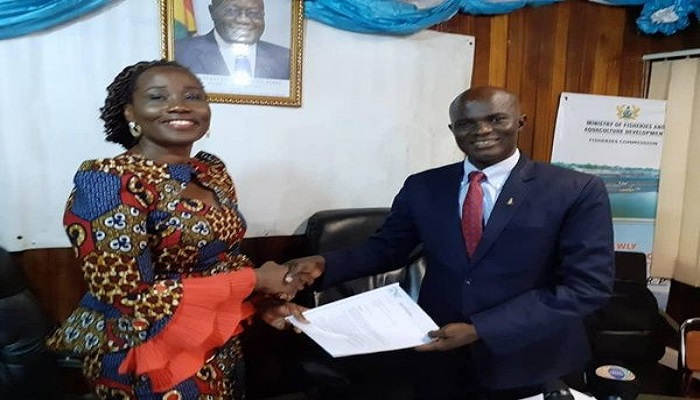 Patricia Safo presenting the petition to the Deputy Fisheries Minister, Kingsley Ato Cudjoe