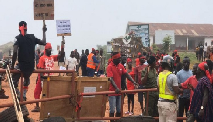 The demonstrators were clad in red, black and repeatedly chanting
