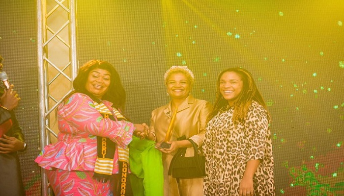 Naana Hayford presenting the overall prize to Velma Owusu-Bempah. With them is Okyere Darko(