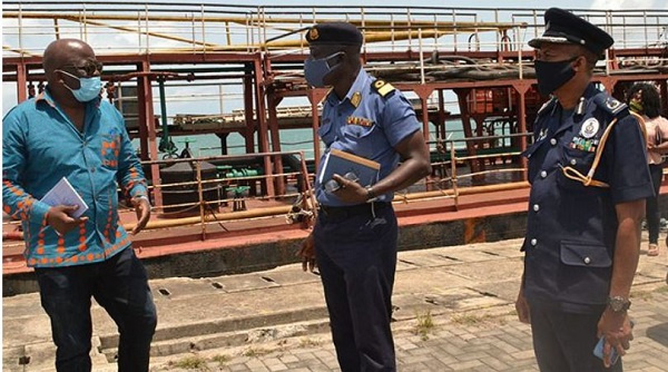 Thomas Alonsi sharing a thought with Cdr Kwafo and DCOP Iddi Seidu
