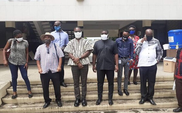 Dr Benard Oko-Boye in Smock and Dr Kwesi Djokoto in a picture with some journalists