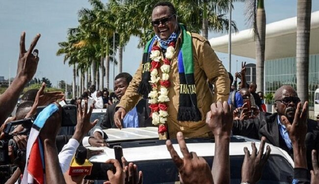 Lissu, reacts to supporters as he returns after three years in exile