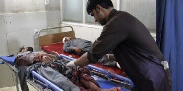 A wounded man receives treatment after the attack in Jalalabad