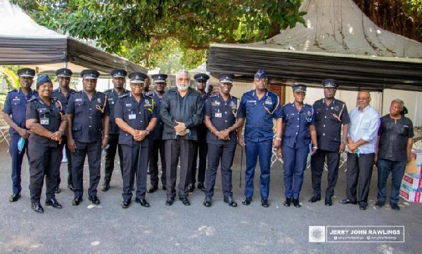 Former President Jerry John Rawlings poses with the Police and EC delegation