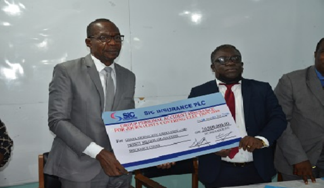 Mr Affail Monney (left) and Mr Faris Attrickie (right) displaying the dummy cheque after the signing ceremony
