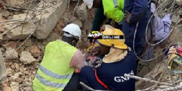 The unidentified woman was saved by the rescue team combing though the debris