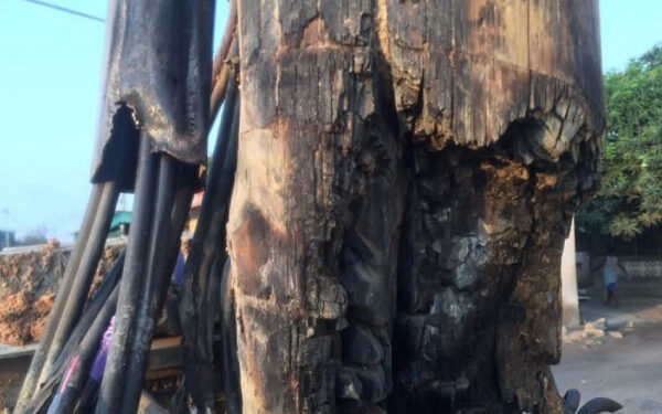 The electric pole was burnt by fire for almost two months