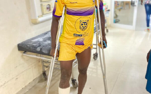 Justice Blay in crutches