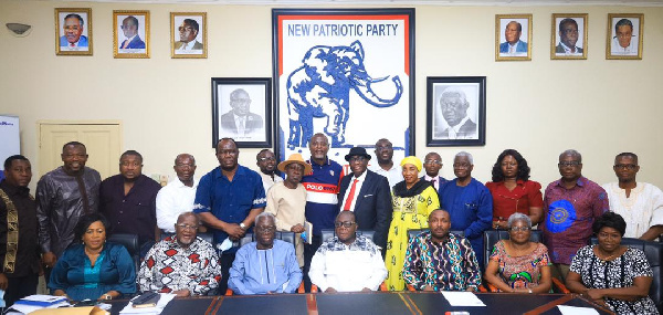 Members of the committee in a photo with executives of the NPP