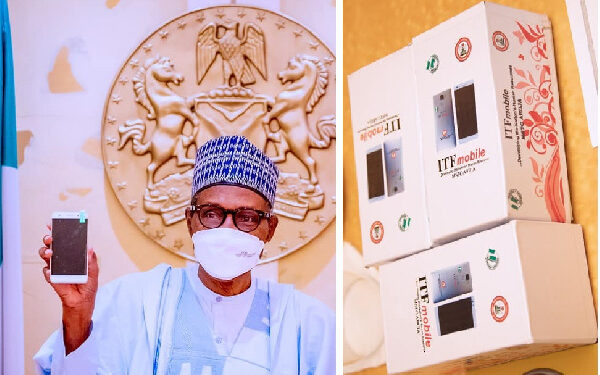 Buhari receives a copy of Nigeria's first locally manufactured smartphone in Abuja