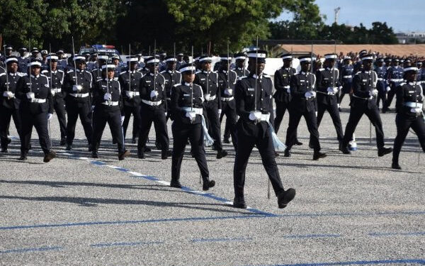 Police officers march during a parade