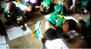 Pupils sit and lie on the floor to write and learn