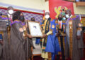 Speaker Bagbin receives his citation on the floor of Parliament