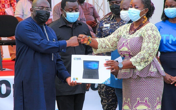 Vice President Bawumia hands over a laptop to the first beneficiary of the initiative